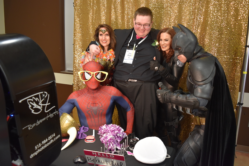 Superheroes and guest in a photo booth
